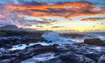 Watch the sunset over the serene waters of Turtle Bay, on the northern tip of Oahu, home of the protected green sea turtle.